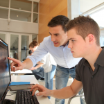 Tutor and student at workstation